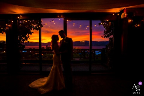 Summerhill Pyramid Winery Wedding Venue Portraits | Sunset at the reception window with the bride and groom