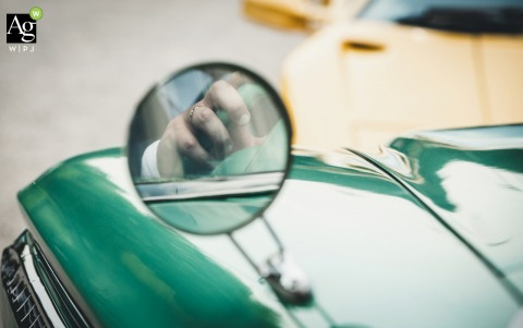 Hostaria Baracca fine art wedding detail photography picture of the Groom's ring reflected in the mirror of a vintage car