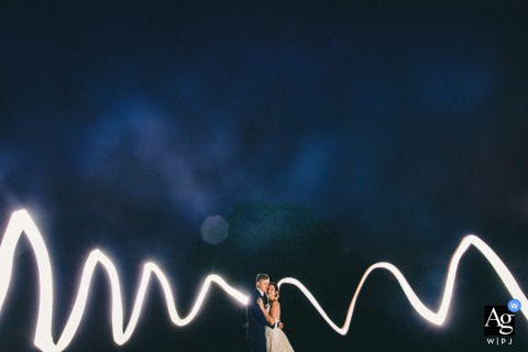 Fine art wedding portrait with a long exposure light painting with couple at the Mythe Barn, Leicestershire, UK