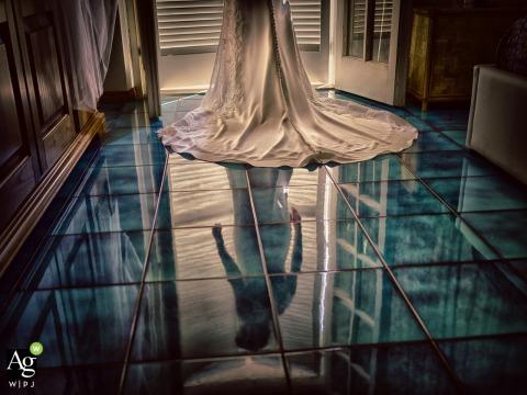 Viareggio fine art wedding portrait image of the bride being reflected on a glass floor by a door