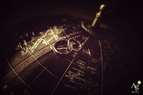 Florence fine art wedding detail photography picture of the rings on a sepia vintage globe