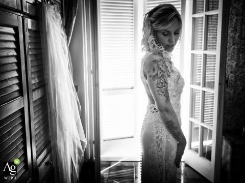 Viareggio black and white wedding portrait of the bride standing near a window