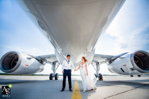 Varna, Bulgaria fine art wedding portrait image showing Love is in the air plane