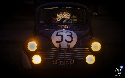 Wedding day portraits Inside a car in Pavie, Gers, France of A couple kissing in a vintage 53 car