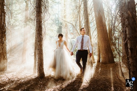 A couple about to marry is Walking on-route to Taft Point for their wedding ceremony in Yosemite National Park, California