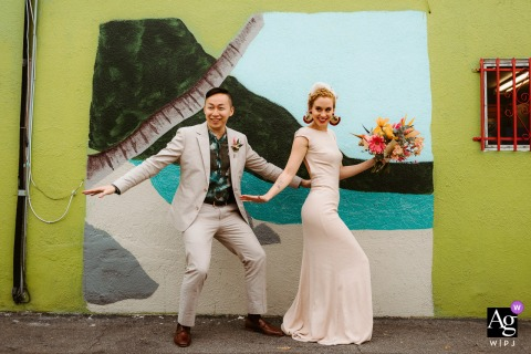 A Los Angeles, California couple taking in the colorful streets of LA during a photo session just after their ceremony