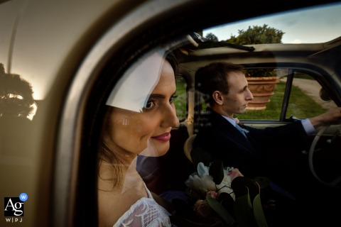 Portrait of the bride groom in their automobile arriving at the church