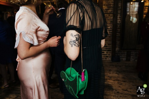 Wilton's Music hall, London fine art wedding detail photography of the tattoo on guest's arm