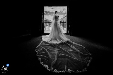 Wedding photo from Getting Ready venue, Hotel Hyatt, La Rosière, French Alps - A Bride portrait in hotel room with view on the mountains