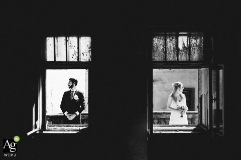Ljubljana, Slovenia black and white wedding portrait In abandoned building next to ceremony location with some Black and White and Bright and Dark