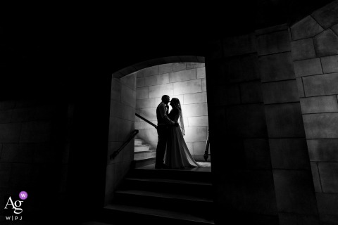 A black and white portrait of bride and groom in stairwell at the Nebraska State Capitol Building (Lincoln, NE)