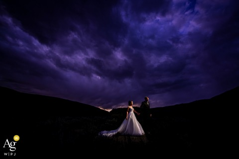 A Camp Hale (Red Cliff, CO) bride and groom portrait under purple sunset
