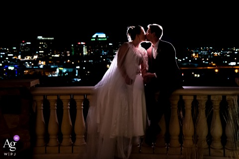 Nighttime photo of bride and groom with city skyline at Pinery at the Hill, Colorado Springs, CO