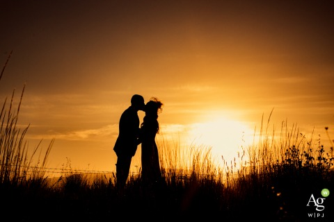 Cappadocia Demissos Cave Hotel artistic wedding couple portrait with a sunset kiss under the warm sky