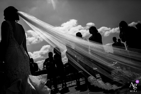 A wedding detail shot of the bride's veil during the ceremony and all silhouetted in Oakand, California