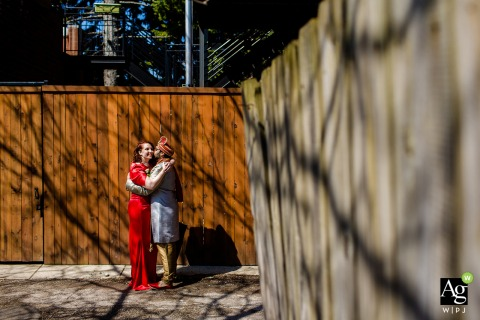 Chicago, Illinois fine art wedding bride and groom portraits with tree branch shadows on wooden fences