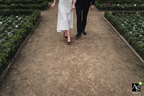 Sens, France fine art wedding detail photography picture of the Bride and groom while walking