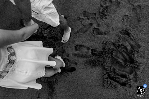 Cecina Beach artistic wedding detail of the sand marked with footprints of a nervous couple