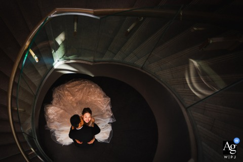 Singapore Hotel staircase wedding couple portrait with a Spiral embrace