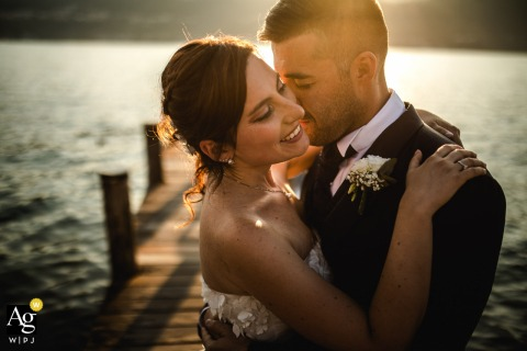 An intimate portrait at the sunset of the bride and groom at the Hotel Ristorante Belvedere, Isola Pescatori, Lake Maggiore, Italy