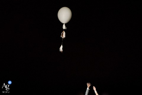Casa de Santa Teresa, RJ artistic wedding photo of the bride and groom launching a balloon