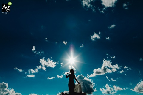 Vinícol Sant'anna, Brazil fine art wedding portrait Silhouette of bride on mountain peak