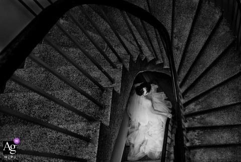 Vietnam Church artistic wedding photo of the bride on spiral stairs with her wedding dress