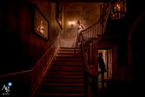 an artistic wedding photo of the bride and groom on the main stairs at The Belmont Country Club
