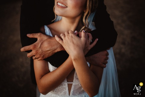 the bride and groom embrace during a portrait session at Venue, Diamante Italy