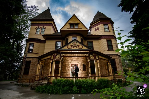 Laramie, WY photo of the bride and groom on the day of the wedding using some of the historic architecture of the Ivinson Mansion