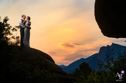 A sunset photo of the bride and the groom during the wedding day reception at Black Canyon Inn, Estes Park