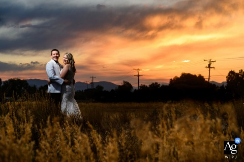 Church Ranch Event Center, Westminster, CO sunset photo taken with the bride and groom during the wedding reception