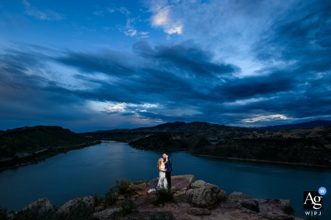 Off-site location near the reception. Fort Collins, CO artistic wedding day portraits at dusk by the lake