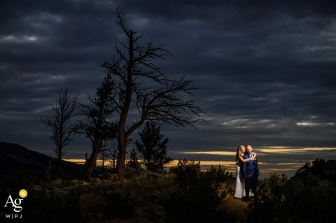An off-site location near the reception site. Fort Collins, COwith a couple at a scenic spot nearby for some sunset photos