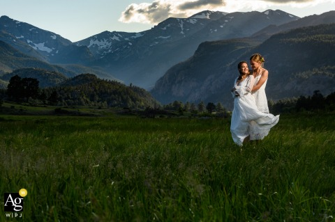 Rocky Mountain National Park, After the wedding ceremony a couple at a scenic spots nearby for some views of the mountains