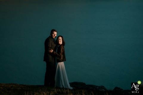 Godley Head, Canterbury New Zealand artistic wedding Couple poses by the waterway for portraits