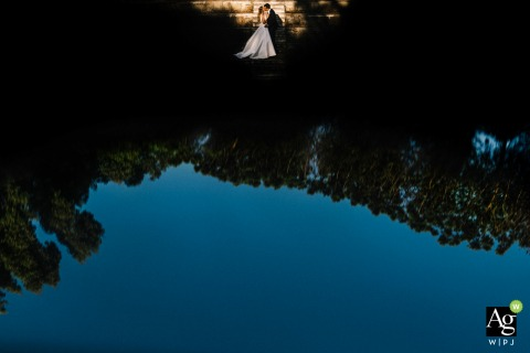 Campania creative wedding day portrait with water reflections outside the ceremony location in Napoli
