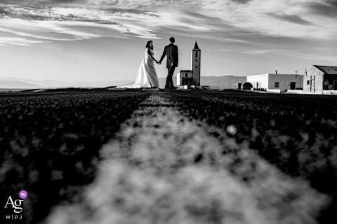 Almería wedding portrait of the bride and groom standing on the road
