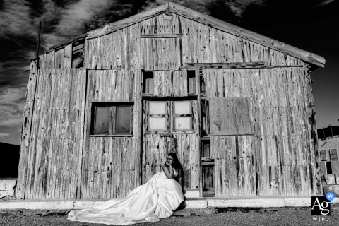 Portrait of the bride sitting outside a old building in Cabo de Gata