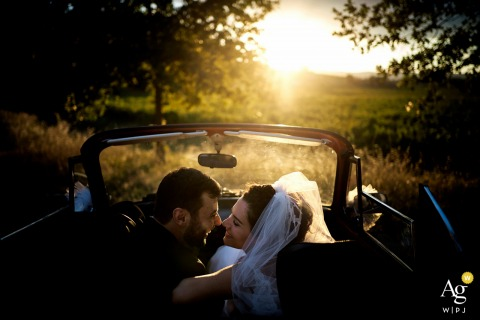 La Scuderia Eventi wedding portrait of the bride and groom in convertible car at sunset