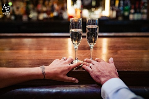New York City fine art wedding detail photography picture of the couple at the hotel bar with champagne