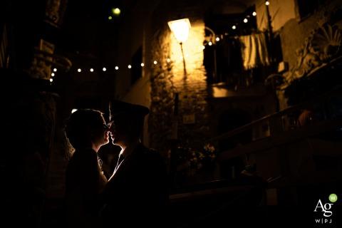 Chianalea fine art wedding portrait image under a string of lights outside at night