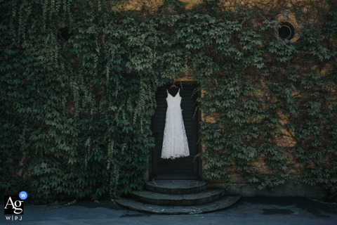 Wedding dress hanging from a doorway at the Vila Široko, Šoštanj