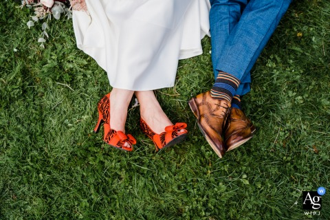 Horsham Park, West Sussex artistic wedding photo of the bride and grooms shoes on the grass