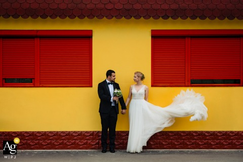 Bulgaria wedding couple portrait with a red and yellow colorful background