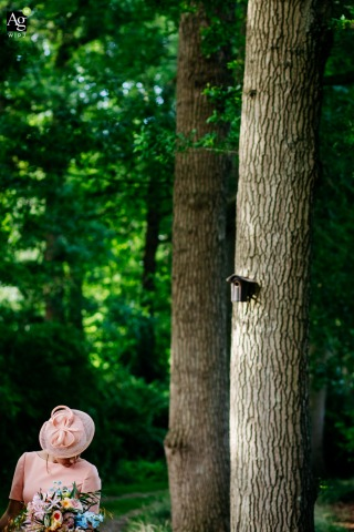 Netherlands fine art wedding detail photography picture of the bride standing below some tall trees