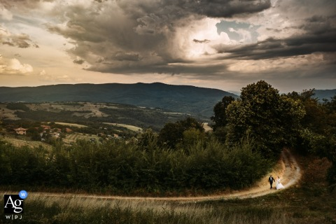 Bride and Groom wedding portrait of the couple walking on a windy road in Elena, Bulgaria