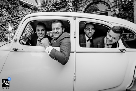 Belgium portrait of the groom and his groomsmen inside an automobile
