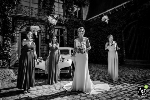 Flanders black and white wedding portrait from the reception venue of the bridesmaids throwing their flowers