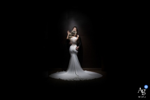 A spotlight illuminates the bride and groom in this Allegro Buffet wedding portrait